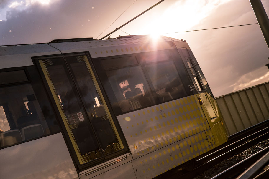 Manchester Metro tram at sunset near Deansgate